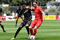 Luke Tongue of Canterbury United competes for the ball with Nathanael Hailemariam of Team Wellington during the ISPS Handa Men's Premiership - Team Wellington v Canterbury Utd at David Farrington Park, Wellington on Saturday 19 December 2020.<br /> Copyright photo: Masanori Udagawa /  www.photosport.nz