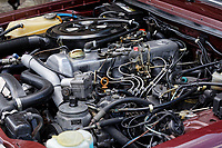 The engine bay of the 1979 Mercedes W123 300 Turbo Diesel from Missouri in the USA, at Gliffaes Hotel near Abergavenny, Wales, UK. Friday 24 August 2019