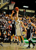 16 January 2012: University of Vermont Vermont Catamounts' guard Josh Elbaum, a Sophomore from Melville, NY, goes up against forward Kilian Cato (23), a Freshman from Espoo, Finland, during game action against the University of Maine Black Bears at Patrick Gymnasium in Burlington, Vermont. The Catamounts defeated the Black Bears 79-65 notching their 10th win of the season. Mandatory Credit: Ed Wolfstein Photo