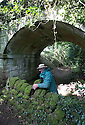"24/05/16 <br /> <br /> Andrew Brown-Jackson secures a coping stone making sure not to damage protected lichens and moss under an ancient sandstone bridge that made up part of the plateway.<br /> <br /> A mammouth restoration project, that could take up to twenty years to complete, is underway on the forgotten ancient stone walls that were once part of an intriguing track way, which pre-dates the railways.<br /> <br /> FULL STORY HERE:  http://www.fstoppress.com/articles/forgotten-stone-walls-set-for-restoration/<br /> <br /> .Imagine a giant 3D jigsaw puzzle with no instructions, and you have an idea of the challenge facing  these traditional dry-stone wallers, who are hard at work restoring the Cauldon Plateway, a relic of Staffordshire's industrial history.<br /> <br /> It's back-breaking work, as each stone has to be returned as close as possible to its original position according to weight and size, with bigger, heavier stones towards the bottom and a rounded ""coping"" stone at the very top.<br /> <br /> All Rights Reserved: F Stop Press Ltd. +44(0)1335 418365   +44 (0)7765 242650 www.fstoppress.com"