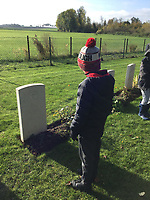 BNPS.co.uk (01202 558833)<br /> Pic: NatashaRook/BNPS<br /> <br /> Pictured: A year 4 pupil beside Private Parr's grave.<br /> <br /> A school has missed out in its bid to buy the medal of the first British soldier killed in World War One after it sold for a whooping £17,000.<br /> <br /> Private John Parr, was shot dead by a German patrol near Mons in Belgium on August 21, 1914.<br /> <br /> The 17-year-old had been deployed in a two-man team as a reconnaissance cyclist to scout out German positions.<br /> <br /> The pair were spotted by the German First Army and a firefight ensued, with Pte Parr heroically sacrificing himself so his comrade could escape unscathed and report back to the British lines.