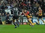 Rhodri Gomer-Davis tackles James Hook. Swansea Neath Ospreys Vs Newport Gwent Dragons, Magners league, Liberty Stadium © IJC Photography. Photographer Ian Cook