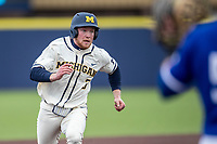 Michigan Wolverines outfielder Miles Lewis (3) runs to third base against the Indiana State Sycamores on April 10, 2019 in the NCAA baseball game at Ray Fisher Stadium in Ann Arbor, Michigan. Michigan defeated Indiana State 6-4. (Andrew Woolley/Four Seam Images)