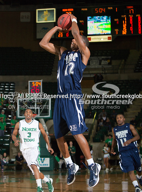 Jackson State Tigers guard Kelsey Howard (12) in action during the game between the Jackson State Tigers and the University of North Texas Mean Green at the North Texas Coliseum,the Super Pit, in Denton, Texas. UNT defeated Jackson State 69 to 55...