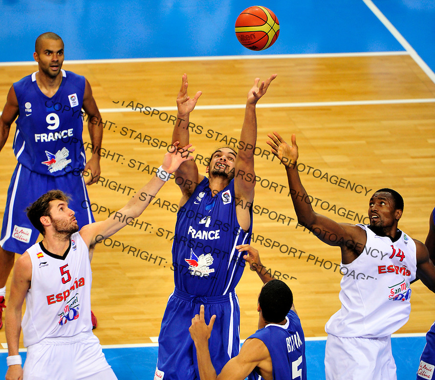 French national basketball team player Noah Joakim (4) fights for the ball with Spanish Ibaka Serge (14) and Fernandez Rudy (5) during final Eurobasket 2011 game between Spain and France in Kaunas, Lithuania, Sunday, September 18, 2011. (photo: Pedja Milosavljevic)