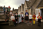 Village junior school pupils dressed up for their school play, with the head teacher.  Sapperton Gloucestershire 1980s