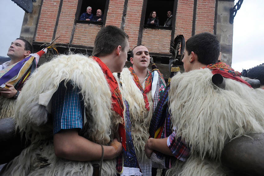 """A group of """"Joaldun""""  attend the carnival carrying sheep furs and big cowbells on their backs on January 27, 2014 at the village of Ituren, Basque Country. Joaldun groups perform an ancient traditional carnival at the villages of Ituren and Zubieta during two days, carrying sheep furs and big cowbells in their backs and making sound them in order to wake up the earth, to ask for a good new year, a good harvest and also to keep away the bad spirits. (Ander Gillenea / Bostok Photo)"""