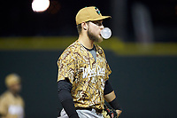 Down East Wood Ducks third baseman Charles Leblanc (33) blows a bubble with his gum while on defense during the game against the Winston-Salem Dash at BB&T Ballpark on May 12, 2018 in Winston-Salem, North Carolina. The Wood Ducks defeated the Dash 7-5. (Brian Westerholt/Four Seam Images)