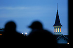 Two men watch the horses go by during a morning workout at Churchill Downs in Louisville, Kentucky on May 5, 2006...