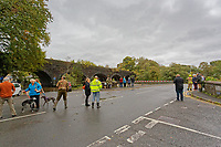 Pictured: Locals gather by the flooded Dulais Fach Road (B4434) between the areas of Aberdulais and Tonna in Neath, south Wales, UK. Saturday 13 October 2018<br /> Re: Flooding caused by Storm Callum in the Neath area, south Wales, UK.