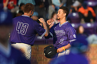 Left fielder Jabari Richards (6) of the Furman Paladins is congratulated by Brandon Elmy in game two of a doubleheader against the Harvard Crimson on Friday, March 16, 2018, at Latham Baseball Stadium on the Furman University campus in Greenville, South Carolina. Furman won, 7-6. (Tom Priddy/Four Seam Images)