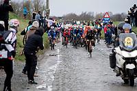 peloton hitting the wet cobbles of the Holle Weg<br /> <br /> 75th Omloop Het Nieuwsblad 2020 (1.UWT)<br /> Gent to Ninove (BEL): 200km<br /> <br /> ©kramon