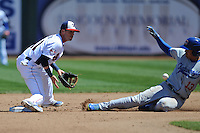Tennessee Smokies second baseman Stephen Bruno #11 fields the throw as Noel Cuevas #13 slides in safely during a game against Chattanooga Lookouts at Smokies Park on April 10, 2014 in Kodak, Tennessee. The Lookouts defeated the Smokies 1-0. (Tony Farlow/Four Seam Images)