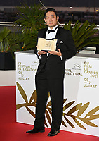 CANNES, FRANCE. July 17, 2021: Ryusuke Hamaguchi at the photocall for Cannes Awards 2021 at the 74th Festival de Cannes.<br /> Picture: Paul Smith / Featureflash