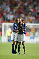 Earnie Stewart consoles Eddie Lewis after the game. The USA lost to Germany 1-0 in the Quarterfinals of the FIFA World Cup 2002 in South Korea on June 21, 2002.