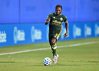 LAKE BUENA VISTA, FL - JULY 18: Yimmi Chará #23 of the Portland Timbers dribbles the ball during a game between Houston Dynamo and Portland Timbers at ESPN Wide World of Sports on July 18, 2020 in Lake Buena Vista, Florida.