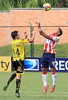 BUCARAMANGA -COLOMBIA-27-02-2014.  Niver Arango de Alianza Petrolera disputa el balon contra Michael Ortega del Atletico Junior  partido por la octava  fecha de la Liga Postob—n 2014-1 realizado en el estadio Alvaro Gomez Hurtado./   Niver Arango of Alianza Petrolera dispute the balloon against Atletico Junior Michael Ortega game for the eighth round of the League held in 2014-1 Postob—n Alvaro Gomez Hurtado Stadium.  Photo:VizzorImage / Duncan Bustamante / Stringer
