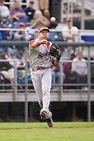 Spokane Indians third baseman Ryan Rua #16 makes a running throw to first base during a game against the Everett AquaSox at Everett Memorial Stadium on June 20, 2012 in Everett, WA.  Everett defeated Spokane 9-8 in 13 innings.  (Ronnie Allen/Four Seam Images)