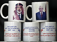 "Mugs are seen for sale with a message regarding the upcoming Annapolis meeting and with portraits of Hamas leader Ismail Haniyeh, right, and Palestinian President Mahmoud Abbas at a souvenir shop in Gaza City, Saturday, Nov. 24, 2007. Israeli, Palestinian, Arab and world leaders are set to meet in Annapolis, Maryland next week at a U.S. hosted mideast peace conference ""photo  by Fady Adwan"""