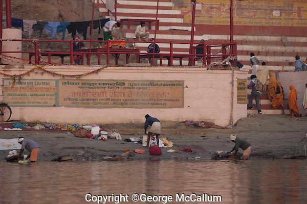 Men washing clothes in Ganges river, Dhobi Ghat, Varanasi, India