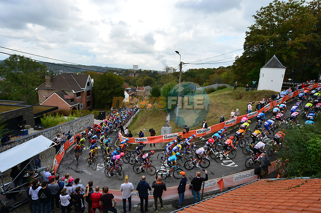 The peloton climb Mur de Huy during La Fleche Wallonne 2020, running 202km from Herve to Mur de Huy, Belgium. 30th September 2020.<br /> Picture: ASO/Gautier Demouveaux | Cyclefile<br /> All photos usage must carry mandatory copyright credit (© Cyclefile | ASO/Gautier Demouveaux)