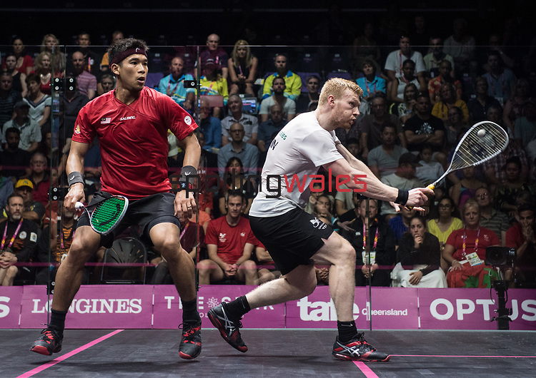 Wales Joel Makin v Malaysia Nafiizwan Adnan<br /> <br /> *This image must be credited to Ian Cook Sportingwales and can only be used in conjunction with this event only*<br /> <br /> 21st Commonwealth Games - Bronze medal deciding match Wales v Malaysia, Squash -  Day 5 - 09\04\2018 - Oxenford Studios, Show Court - Gold Coast City - Australia