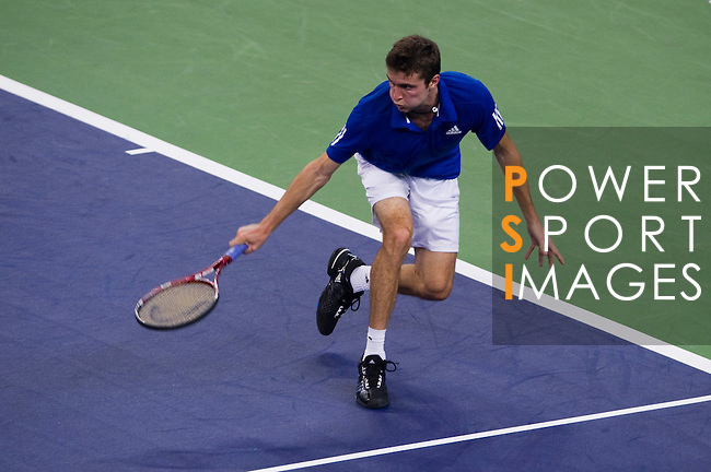 SHANGHAI, CHINA - OCTOBER 11:  Gilles Simon of France returns a ball to Stanislas Wawrinka of Switzerland during day one of the 2010 Shanghai Rolex Masters at the Shanghai Qi Zhong Tennis Center on October 11, 2010 in Shanghai, China.  (Photo by Victor Fraile/The Power of Sport Images) *** Local Caption *** Gilles Simon
