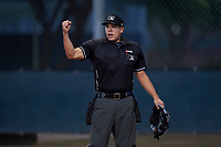 Umpire Jesse Segura calls a runner out at home plate during an Arizona League game between the AZL Mariners and AZL D-backs on July 3, 2019 at Salt River Fields at Talking Stick in Scottsdale, Arizona. The AZL D-backs defeated the AZL Mariners 3-1. (Zachary Lucy/Four Seam Images)