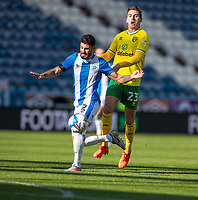 12th September 2020 The John Smiths Stadium, Huddersfield, Yorkshire, England; English Championship Football, Huddersfield Town versus Norwich City;  Richard Stearman of Huddersfield Town shields the ball from  Kenny McLean of Norwich City