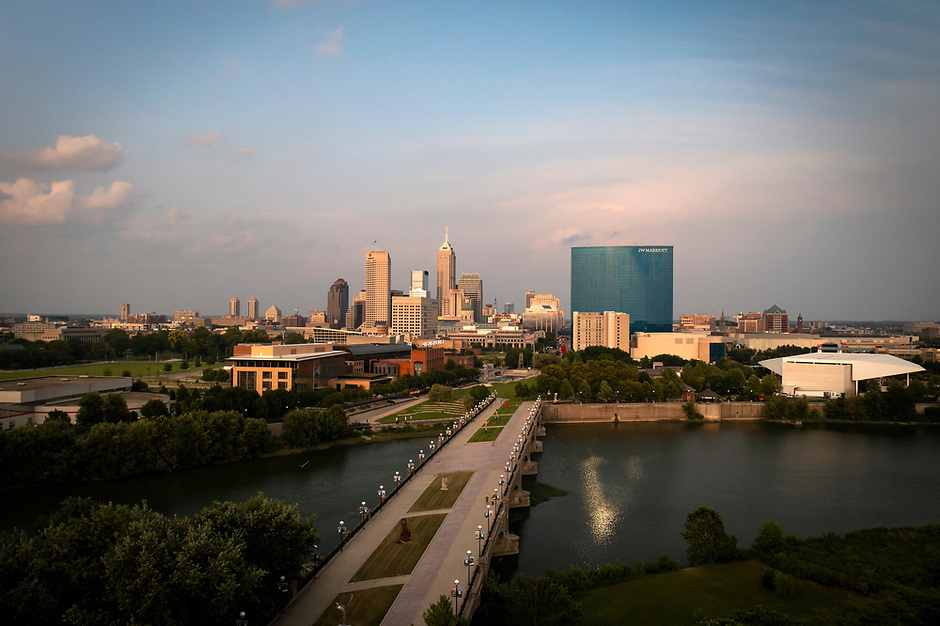 The White River flows past the downtown Indianapolis skyline on a summer evening on Saturday, Aug. 7, 2021. (Photo by James Brosher)
