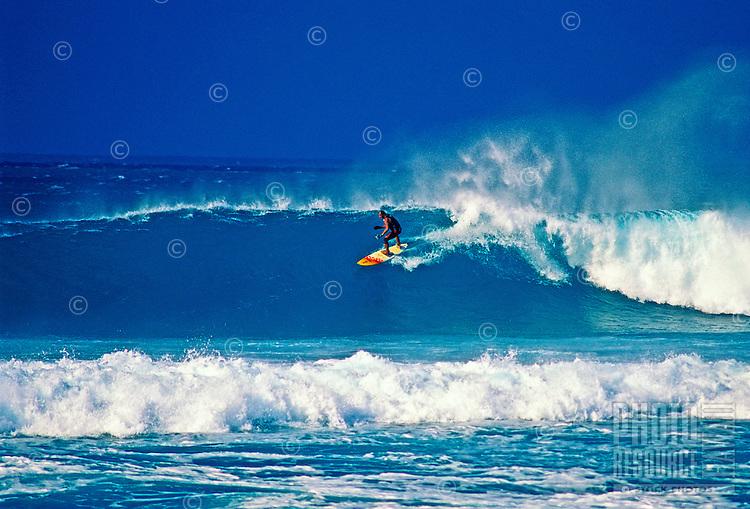 Surfing off Hookipa beachpark on Maui.