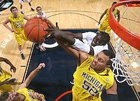 CHARLOTTESVILLE, VA- NOVEMBER 29: Jordan Morgan #52 of the Michigan Wolverines reaches for a rebound with Assane Sene #5 of the Virginia Cavaliers during the game on November 29, 2011 at the John Paul Jones Arena in Charlottesville, Virginia. Virginia defeated Michigan 70-58. (Photo by Andrew Shurtleff/Getty Images) *** Local Caption *** Assane Sene;Jordan Morgan