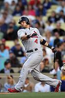 Yadier Molina #4 of the St.Louis Cardinals bats against the Los Angeles Dodgers at Dodger Stadium on May 18, 2012 in Los Angeles,California. Los Angeles defeated St.Louis 6-5.(Larry Goren/Four Seam Images)
