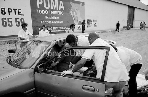 Culiacan, Mexico<br /> June 13, 2007<br /> <br /> A drug related execution, adding to the more then 300 this year in Cuilacan. Felipe Rodríguez Peraza, 35, found on the road to Navolato with four bullet wounds inside of his car.  He was the DJ at a table dance club called Osiris. There had been two other guys from table dancing clubs killed in the last four days, this being the 3rd one.