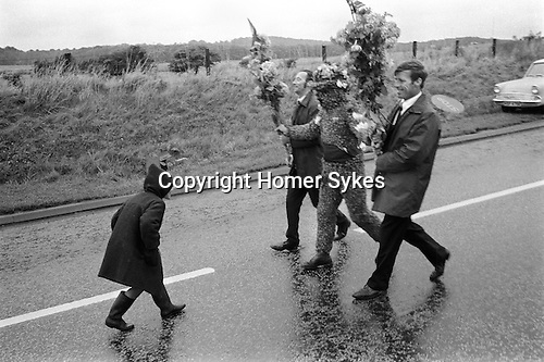 The Burry Man - John ( Jacko) Hart, South Queensferry Lothian Scotland. UK. With his helpers Billy Scott and David Scott . Walking the towns boundaries. Second Friday in August 1971. John (Jacko) Hart was the local grave digger in 1971.