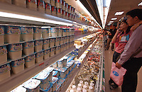 Shoppers at the milk and yogurt section of cold storage in a supermaerket, Guangzhou, China..18-DEC-04