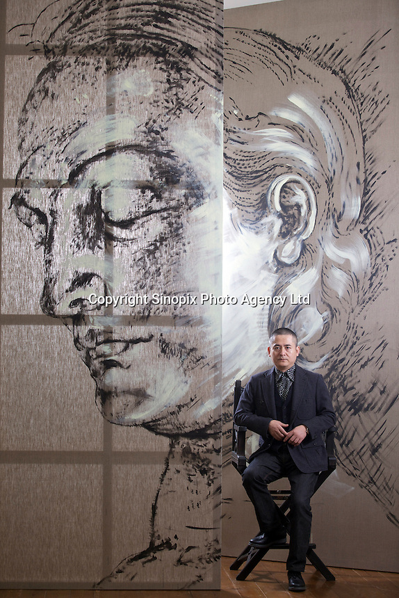 "Zeng Fanzhi, China's renowned contemporary artist, poses for pictures between an unfinished painting in his Beijing studio on 9th November, 2012, China. Zeng gained the title of ""Number One"" Chinese artist in terms of auction price in 2009.<br /> <br /> By Ricky Wong / Sinopix"
