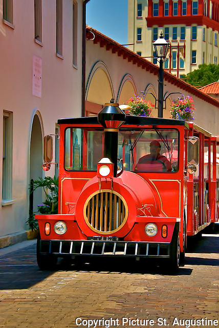 """A """"Red Train"""" travels down Aviles Street in historic St. Augustine, Florida."""