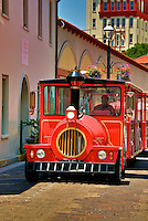 "A ""Red Train"" travels down Aviles Street in historic St. Augustine, Florida."