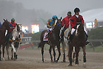 May 16, 2015: Preakness contenders, including American Pharoah (#1), take part in a rain-drenched post parade. American Pharoah, Victor Espinoza up,  wins the Preakness Stakes at Pimlico Race Course in Baltimore, MD. Trainer is Bob Baffert; owner is Ahmed Zayed. Joan Fairman Kanes/ESW/CSM