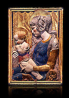 Painted terracotta relief panel depicting the Virgin and Child by Niccolo Bardi better known as Donatello. Made in Florence around 1386. Inv RF 353, The Louvre Museum, Paris.