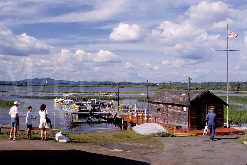 Adirondacks, New York, NY, Moody, Family waiting to rent a boat on Tupper Lake in Adirondack Park.