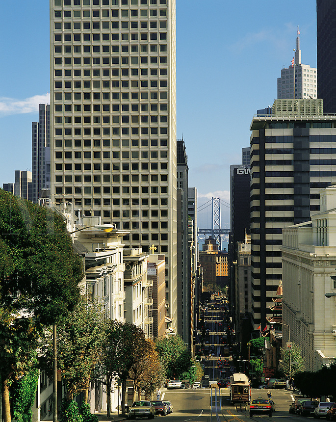 Downtown San Francisco among skyscrapers and office-blocks with the Bay Bridge in distance, California, US