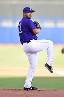 Tulsa Drillers pitcher Carlos Hernandez (11) delivers a warmup pitch during the second game of a doubleheader against the Frisco Rough Riders on May 29, 2014 at ONEOK Field in Tulsa, Oklahoma.  Frisco defeated Tulsa 3-2.  (Mike Janes/Four Seam Images)