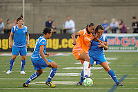 Rosana (11) of Sky Blue FC is marked by Angela Hucles (16) and Christine Latham (7) of the Boston Breakers. Sky Blue FC defeated the Boston Breakers 2-1 during a WPS regular season match at Harvard Stadium in Boston, MA, on July 12, 2009.