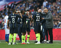 Manchester City manager Pep Guardiola gives instructions to his players<br /> <br /> Photographer Rob Newell/CameraSport<br /> <br /> Emirates FA Cup Semi-Final - Manchester City v Brighton & Hove Allbion - Saturday 6th April 2019 - Wembley Stadium - London<br />  <br /> World Copyright © 2019 CameraSport. All rights reserved. 43 Linden Ave. Countesthorpe. Leicester. England. LE8 5PG - Tel: +44 (0) 116 277 4147 - admin@camerasport.com - www.camerasport.com