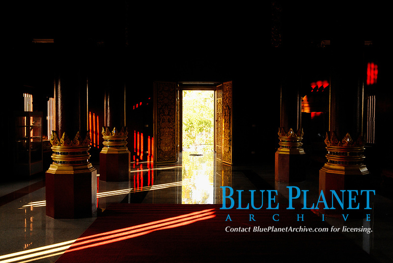 Rays of light going thru an opened door a Buddhist temple in Chiang Mai city, Thailand, Southeast Asia.