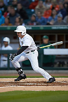 Austin Lynch (45) of the Charlotte 49ers follows through on his swing against the Clemson Tigers at BB&T BallPark on March 26, 2019 in Charlotte, North Carolina. The Tigers defeated the 49ers 8-5. (Brian Westerholt/Four Seam Images)
