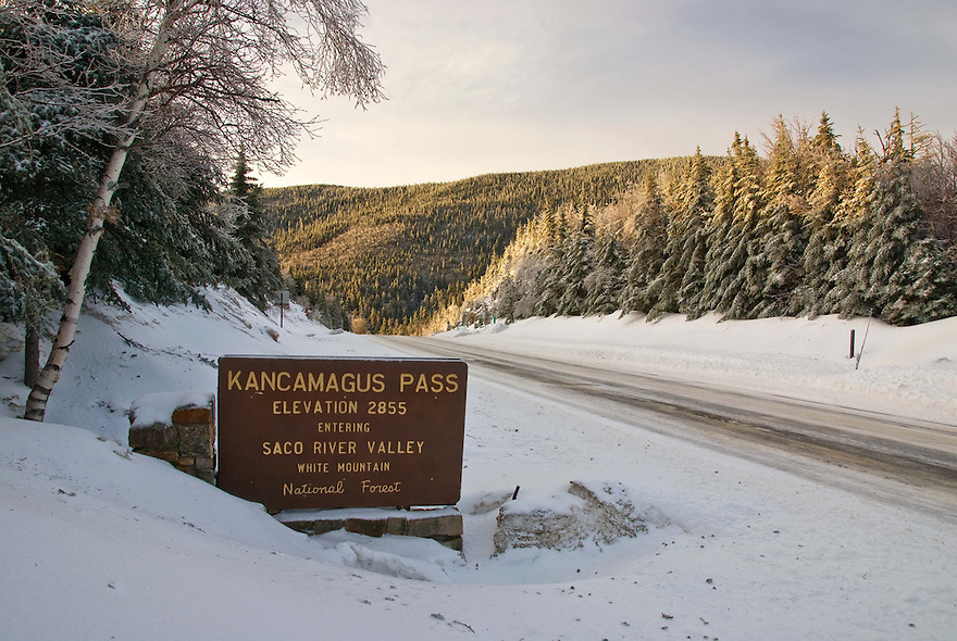 Dawn brings new snow to the height of land on the Kancamagus Highway in the heart of New Hampshire's White Mountains.