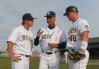 Pitching coach Derek Botelho, center, of the Lynchburg Hillcats, goes over the game plan with starting pitcher Matt Crim (15), left, and catcher Shawn McGill (48) prior to a game against the Wilmington Blue Rocks on June 15, 2011, at City Stadium in Lynchburg, Va. (Tom Priddy/Four Seam Images)